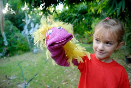 Child (6 years old) showing her red handmade hand puppet.